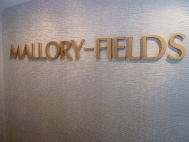 Mallory-Fields Interior Design logo on the wall of the showroom