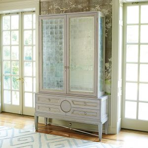 Entryway featuring high end home furnishings including a mirrored armoire